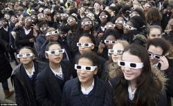 Eclipse students wearing protective glasses image