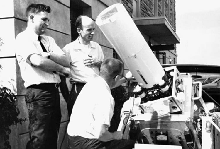 Jack Eddy, John Firor, and Bob Lee prepare the eclipse expedition coronagraph for 1966 eclipse expedition to Bolivia