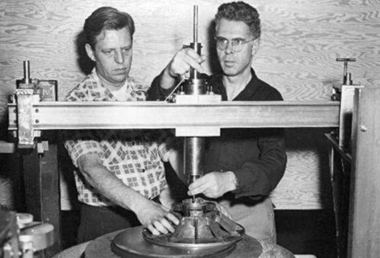 Frederick B. Pearson, chief optician for the observatory, and Dr. John W. Evans grind a coronagraph lens, 1951